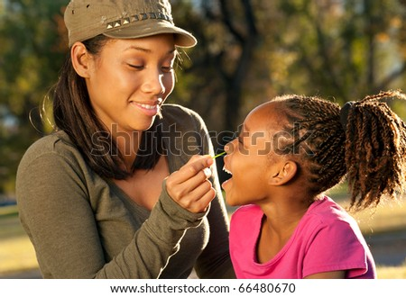 African American mother and child playing together - stock photo