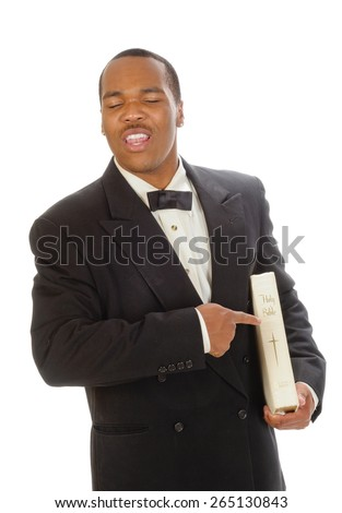 African American preacher holding and pointing at a bible, while preaching, isolated over white - stock photo