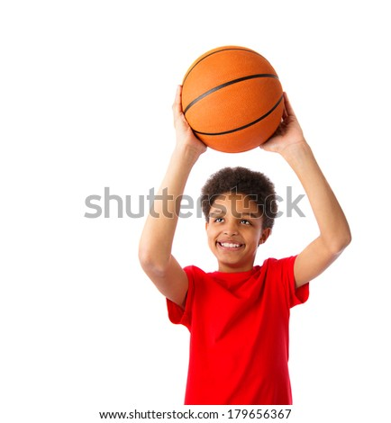 African American school boy smiling and playing basketball, half body portrait. Isolated, over white background, with copy space - stock photo