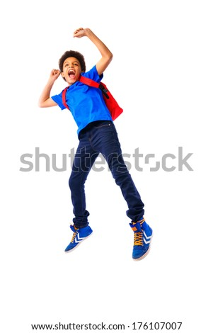 African American school boy, teenager smiling and jumping happy,education and school concept. Isolated, over white background, with copy space. Full body portrait.  - stock photo