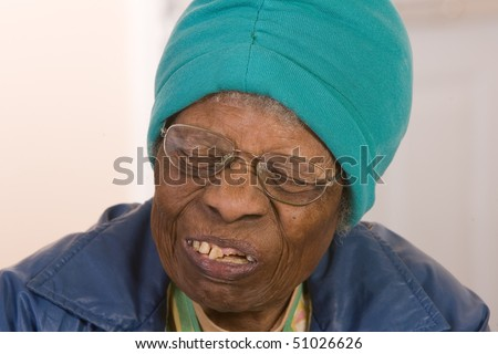 African American senior citizen woman in pain - stock photo