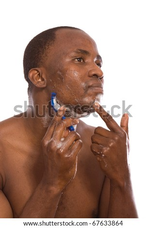 african american shaving his face - stock photo