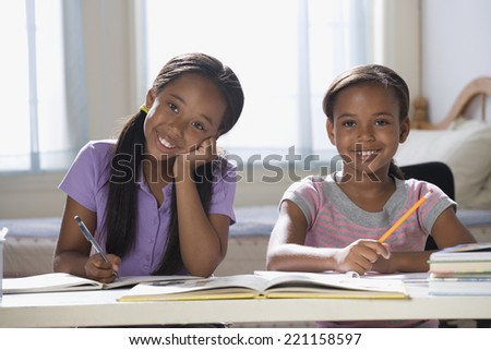 African American sisters studying - stock photo