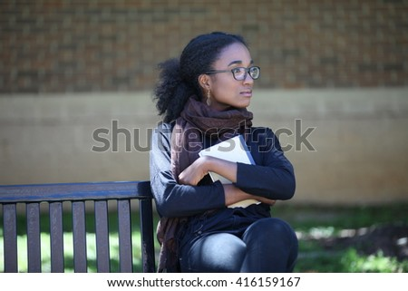 African American student girl, beautiful girl adult, with glasses, campus, outside, school girl outside, cute black young girl, smile, education, university, unites states, laptop, homework, glasses - stock photo