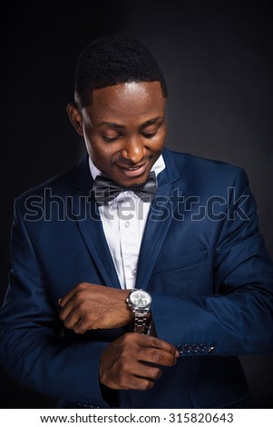 African american successful businessman on black background - stock photo