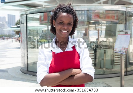 African american waitress in front of the restaurant - stock photo