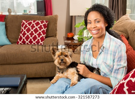 African american woman and her dog at home - stock photo