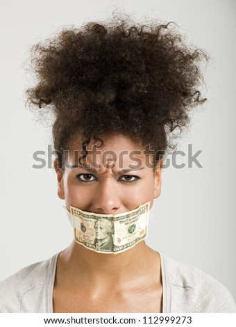 African American woman covering her mouth with a dollar banknote, great concept for the global crises - stock photo