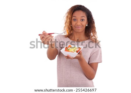 African American woman eating salad, isolated on white background - Black people - stock photo