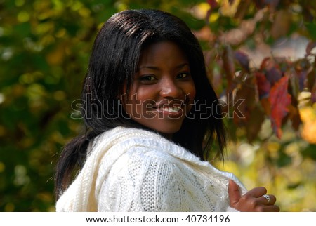 African-American woman enjoying a fall day outside - stock photo