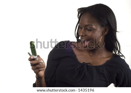 african american woman excited about a cell message - stock photo