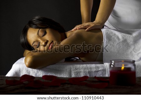 African-American woman getting a massage - stock photo