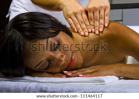 African American woman getting a massage - stock photo