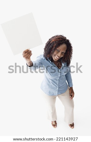 African American woman holding blank sign - stock photo