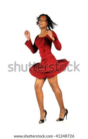 African American woman in red dress dancing over white background - stock photo