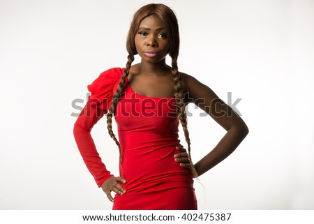 African-american woman in red dress standing on white background - stock photo