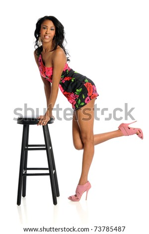 African American woman leaning on stool isolated over white background - stock photo