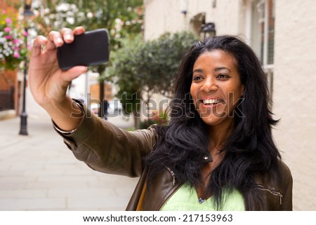 african american woman taking a selfie - stock photo