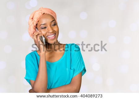 African American woman talking on a mobile phone - stock photo