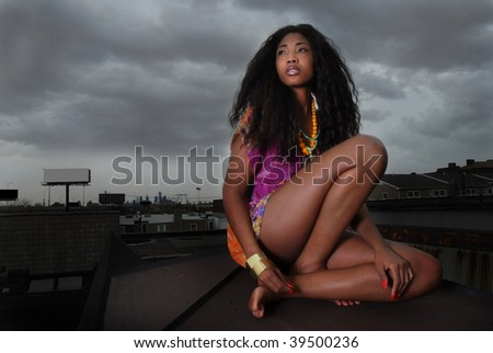 african american woman thinking as she stares - stock photo