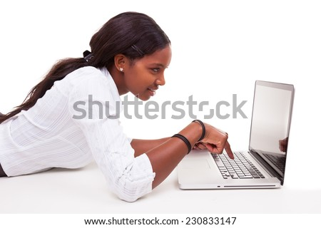 African American woman using a laptop - Black people , isolated on white background - stock photo