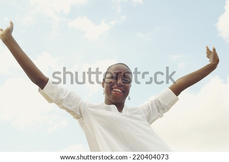 African American woman with arms raised - stock photo