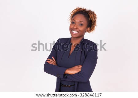 African American woman with folded arms, isolated on grey background - Black people - stock photo