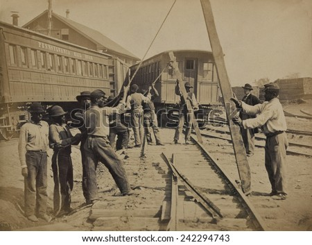 African American work crew in northern, Virginia, using levers for loosening rails, as part of the Union Military Railway Service. Ca. 1862 photo by Andrew J. Russell - stock photo