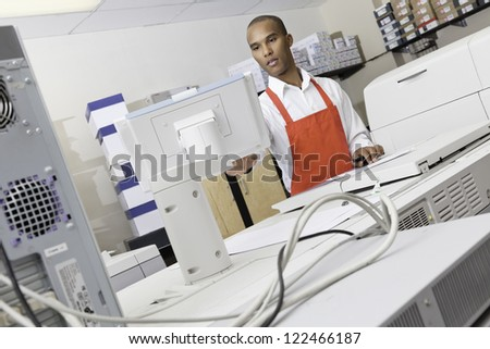 African American working on printing factory - stock photo