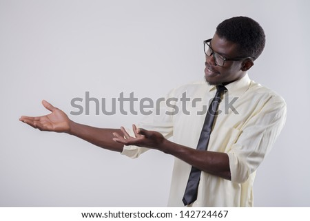 African-American young man holding something - stock photo