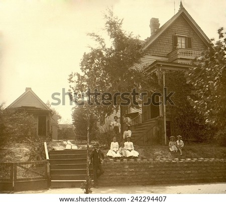 African Americans posed in front of their middle class home in Georgia, ca. 1899. Some urban blacks were able to prosper in spite of U.S. racial discrimination from 1890-1940. - stock photo