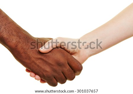 African and European shaking their hands for greeting - stock photo