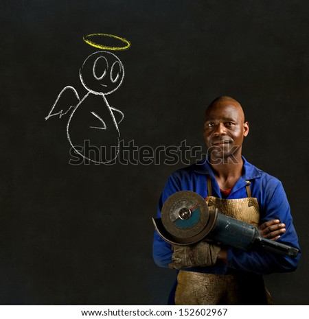African black man industrial worker with chalk angel on blackboard background - stock photo