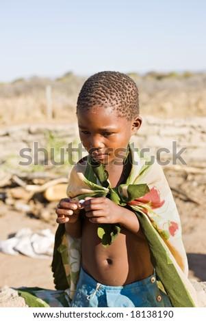 african boy living in a very poor community in a village near Kalahari desert - stock photo
