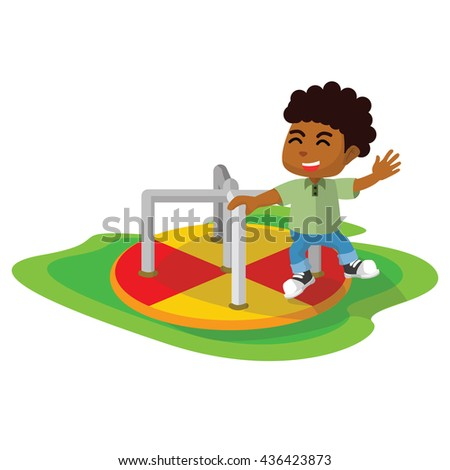 African boy playing at park merry go round - stock photo