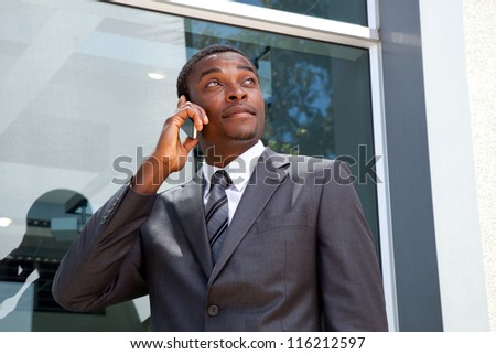 African business man on his cell phone - stock photo