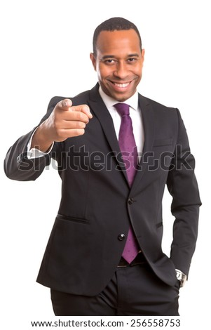 African business man poiting at you, isolated over white - stock photo