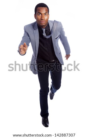 African business man running isolated on white background - stock photo