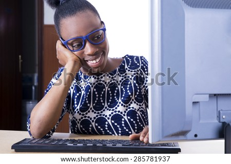 African business woman working with computer - stock photo