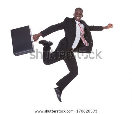 African Businessman Running Holding Briefcase Over White Background - stock photo