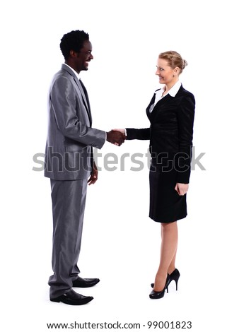 African businessman shaking hands with white business woman - stock photo