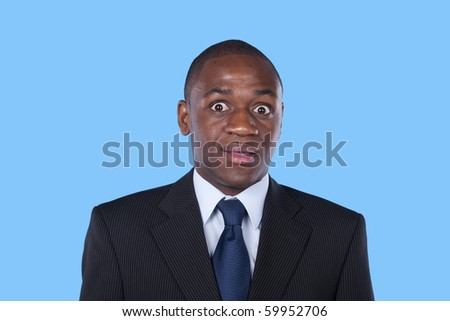 african businessman surprised expression - stock photo