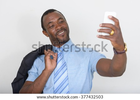 African businessman taking selfie - stock photo