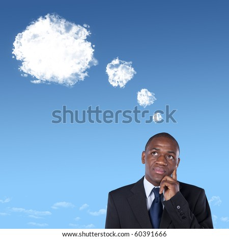 African businessman thinking with a thought bubble made of clouds - stock photo