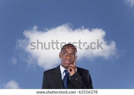 African businessman thinking with cloud on the background (cloud computing concept) - stock photo