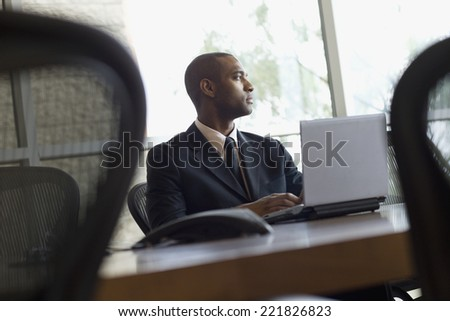African businessman typing on laptop - stock photo