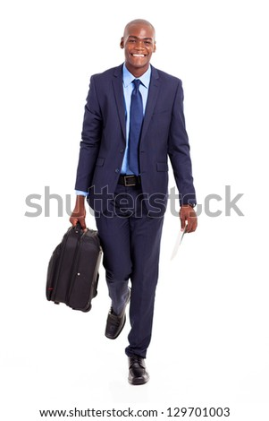 african businessman walking with suitcase isolated on white - stock photo