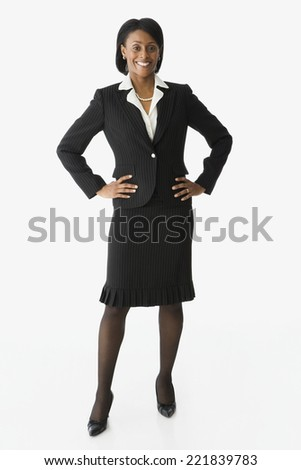 African businesswoman with hands on hips - stock photo