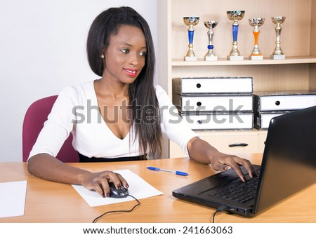 african businesswoman working with smile in the office  - stock photo