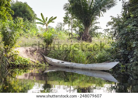 African canoe at the shore of tropical island - stock photo
